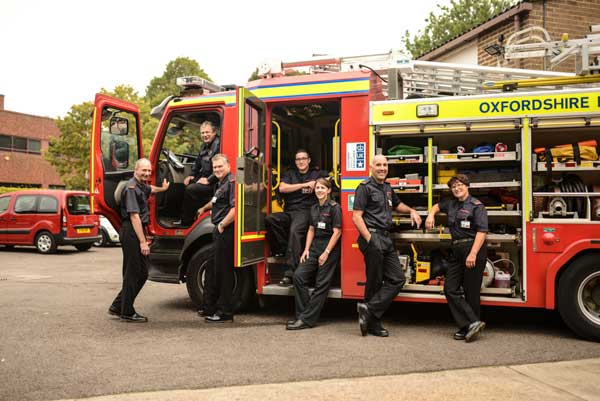 Fire officers next to an appliance
